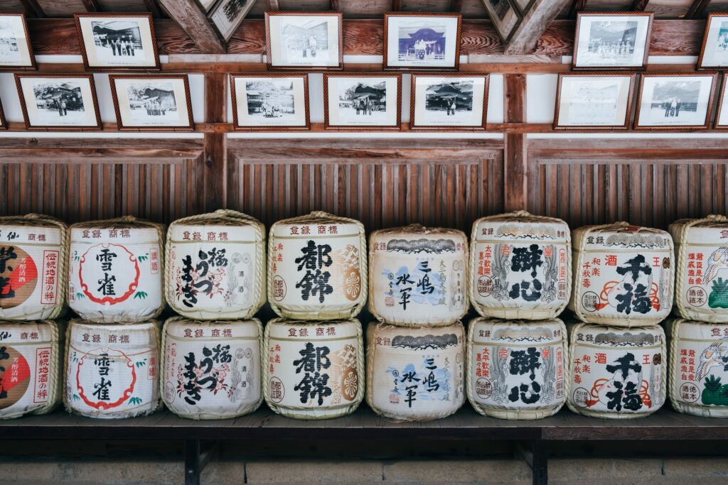Photos and objects with japanese characters written on them on a store shelves.
